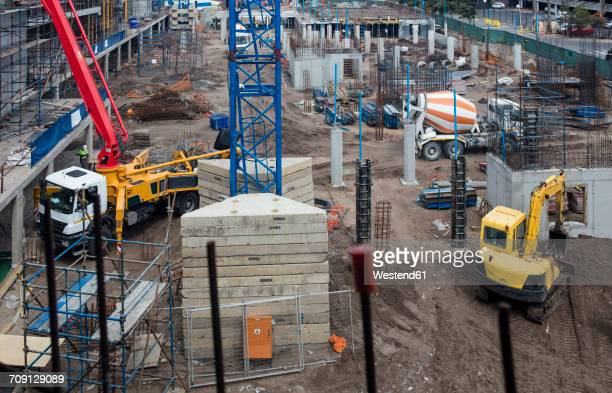concrete pump and other machinery on construction site - crane construction machinery stock pictures, royalty-free photos & images