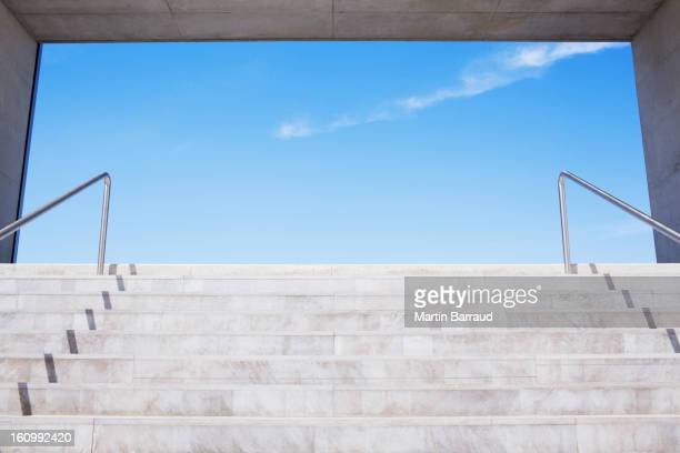Concrete steps leading to blue sky