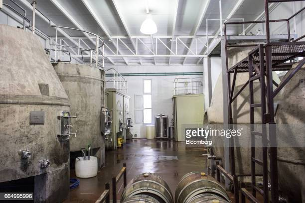 Concrete tanks sit in the research and development area of the Bodega Santa Julia production facility in Mendoza Argentina on Tuesday March 23 2017...