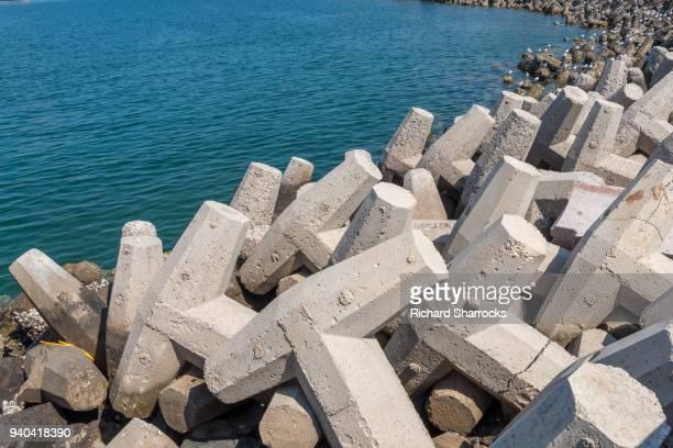 Concrete tetrapod coastal defence structure