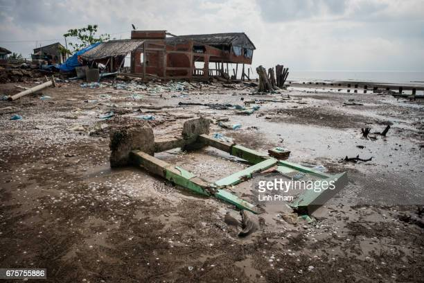 A concrete tourist sign was destroyed bt the high tides near the seafront on April 29 2017 in Bao Thuan Village Ba Tri District Ben Tre Province...