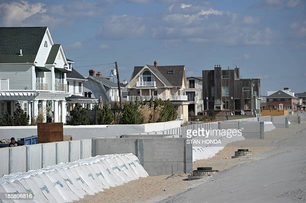 Concrete wall and large sand bags built by New York City in front of homes at Beach 142nd Street in the Rockaway section of the Queens borough of New...