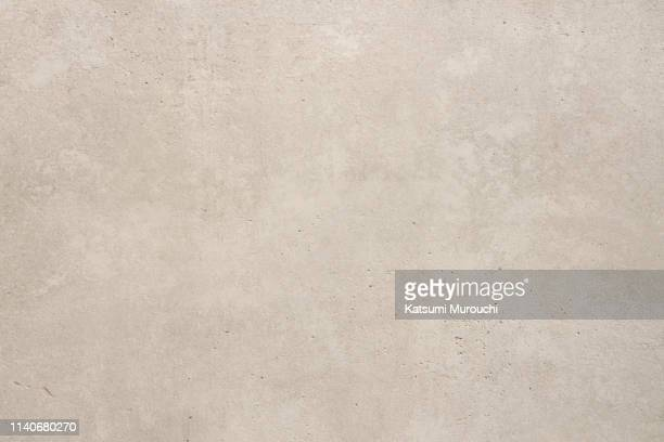 concrete wall texture background - beige foto e immagini stock