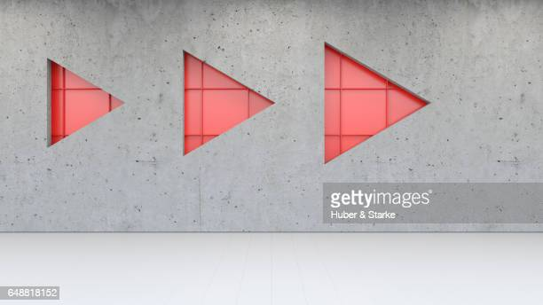 concrete wall with red metallic structure