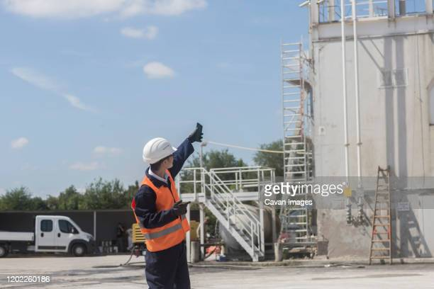 concrete worker in a excavator - jacket stock pictures, royalty-free photos & images