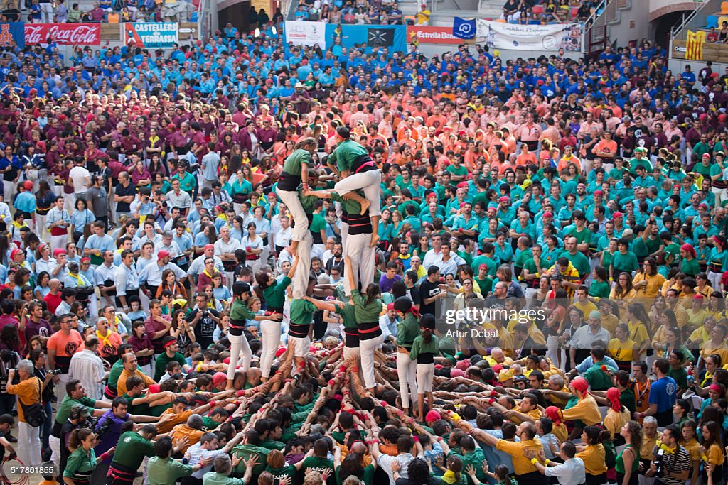 Concurs de Castells in Tarragona, a biannual championship where all human castle groups (colles castelleres) compete in one weekend. Saturday October 4th of 2014. Catalonia Europe.