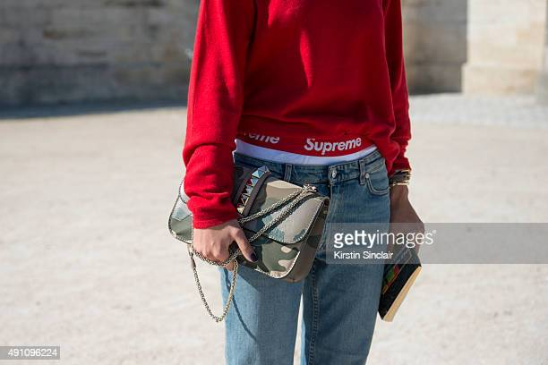 Conde Nast Germany Emine Yildiz wears a Uniqlo top Acne jeans and Valentino bag on day 4 during Paris Fashion Week Spring/Summer 2016 on October 2...