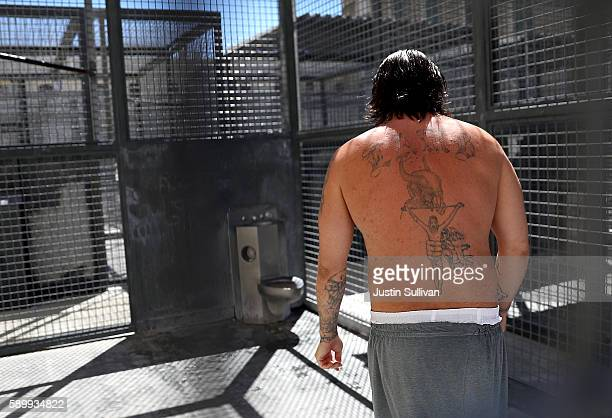 A condemned inmate stands in a cell in the yard outside of San Quentin State Prison's death row adjustment center on August 15 2016 in San Quentin...
