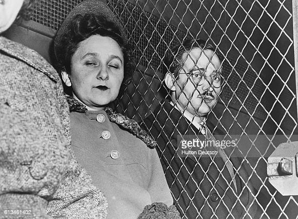 Condemned spy Julius Rosenberg sits manacled in a United States Marshal's van en route to the Federal House of Detention New York His wife Ethel sits...