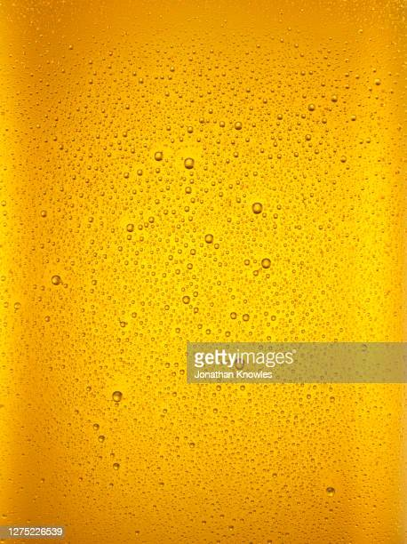 condensation droplets on beer glass - glass material stock pictures, royalty-free photos & images