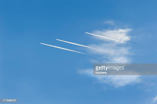 condensation - jet  plane trail of three aeroplanes - parallel stock pictures, royalty-free photos & images