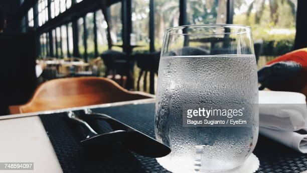Condensed Glass On Table In Cafe