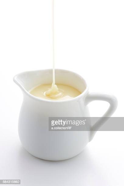 Condensed milk being poured into pitcher