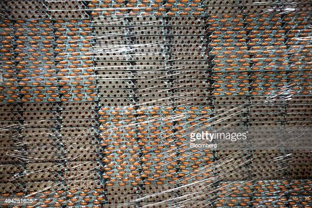 Condensers sit stacked on the cabinet assembly line of the Carrier Midea Pvt manufacturing facility in Bawal Haryana India on Tuesday May 27 2014...