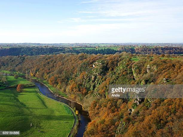 CondesurVire on Les Roches de Ham a 105 meters high shale rock face overhanging the Vire river aerial view in autumn