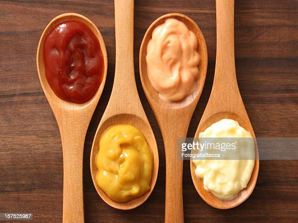 condiments and spoons - tomato sauce stock pictures, royalty-free photos & images