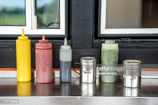 "condiments at the chip truck wagon - ""danielle donders"" stock pictures, royalty-free photos & images"