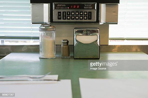 condiments on a diner counter - diner stock pictures, royalty-free photos & images