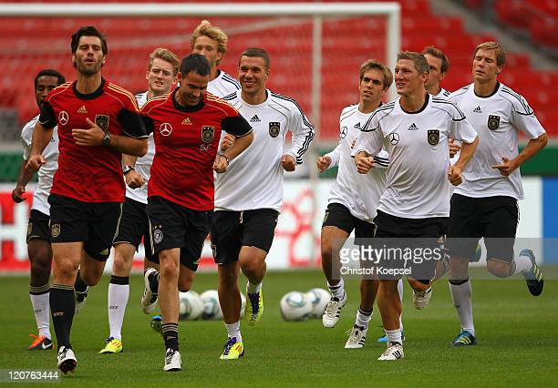 Condition coach Benjamin Kugel condition coach Shad Forsythe Lukas Podolski Philipp Lahm Bastian Schweinsteiger Mario Goetze and Holger Badstuber...