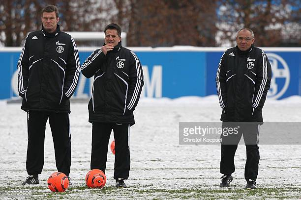 Condition coach Markus Zetlmeisl, condition coach Werner Leuthard and head coach Felix Magath attend the FC Schalke training session at the training...