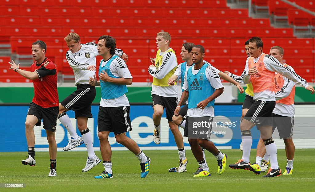 Condition coach Shad Forsythe, Benedikt Hoewedes, Mats Hummels, Sven Bender, Christian Traesch, Dennis Aogo, Ilkay Guendogan, Miroslav Klose and Lukas Podolski attend a training session of the German National football team at Mercedes-Benz Arena on August 8, 2011 in Stuttgart, Germany. Germany will play a friendly match against Brazil at Mercedes-Benz Arena on August 10, 2011 in Stuttgart, Germany.