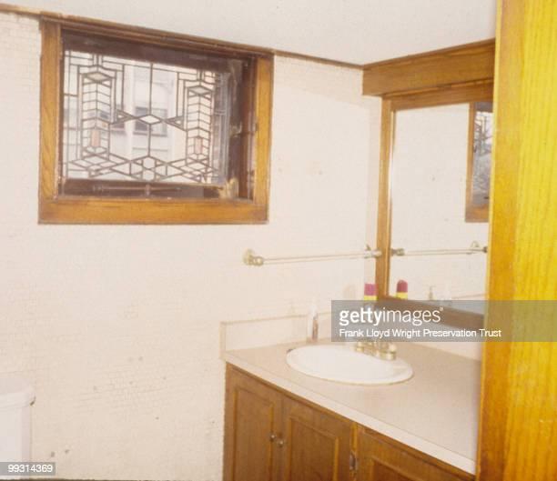 Condition of main floor guest bathroom prerestoration nonoriginal builtin sink and mirror visible Chicago Illinois April 15 1997
