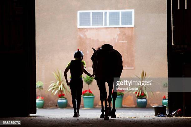 Conditional Jockey Conor Smith heads out from the stables for third lot at Sandhill Racing Stables on July 22 2015 in Minehead England Sandhill...