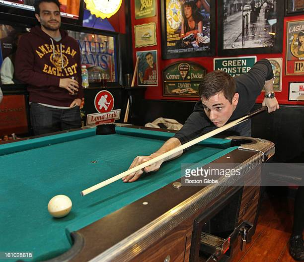 Conditions during the storm: Bryan Weilacher plays pool at Conor Larkin's Grill & Tap.