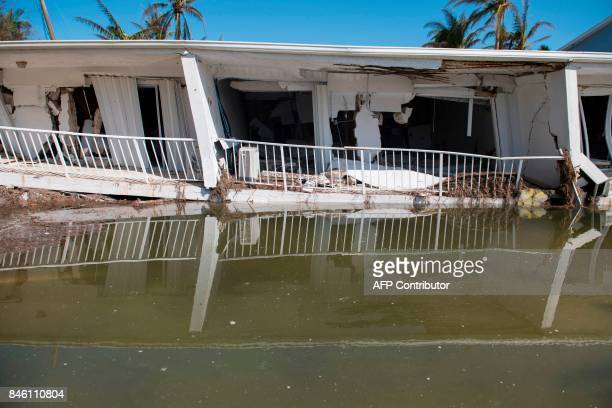 A condo building destroyed by Hurricane Irma that had been 3stories tall before collapsing in the storm is seen in Islamorada in the Florida Keys...