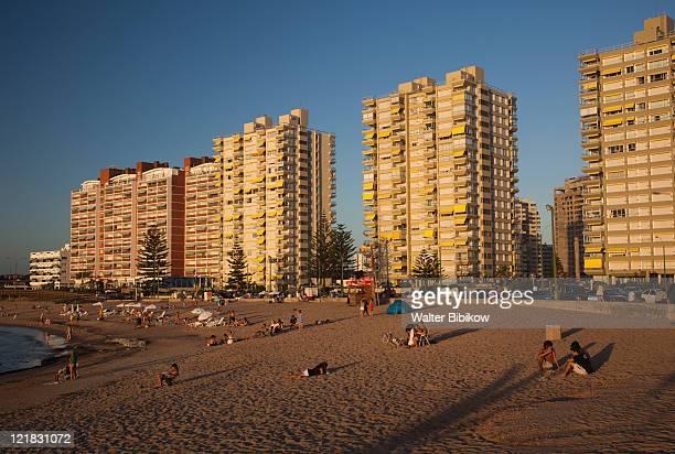 condo buildings along playa mansa beach at sunset, punta del este, uruguay, february 2009  - uruguay stockfoto's en -beelden