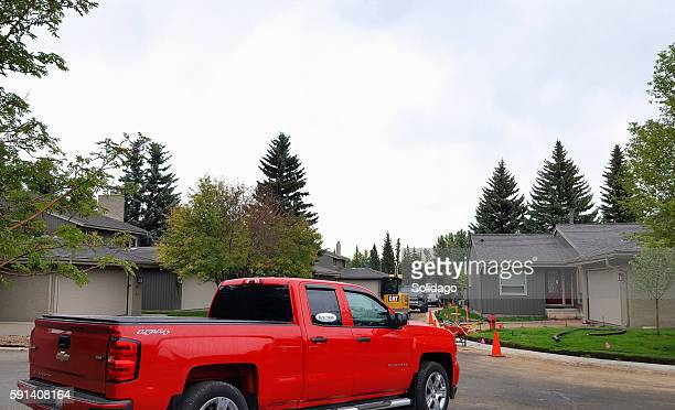 condo residential street and driveway upgrading - curbside pickup stock pictures, royalty-free photos & images