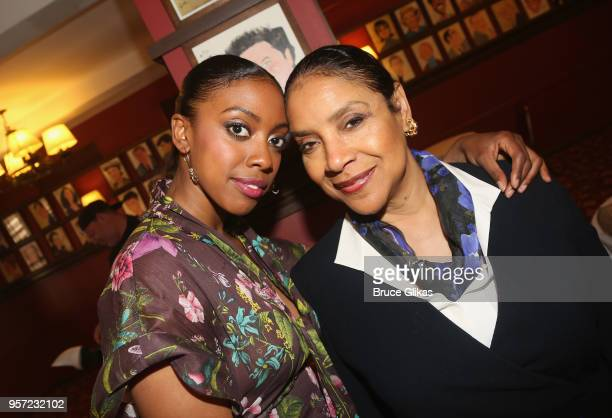"""Condola Rashad and her mother Phylicia Rashad pose as Condola Rashad recieves her caricature for her role in the MTC play """"St. Joan"""" at Sardis on May..."""