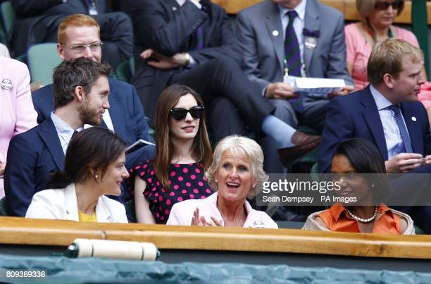 Condoleezza Rice and Anne Hathaway watch the Women's Single's Final between Russia's Maria Sharapova and Czech Republic's Petra Kvitova on day twelve...