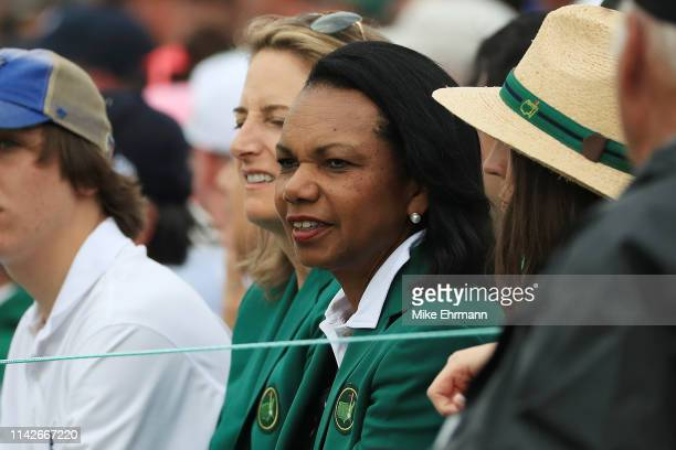 Condoleezza Rice former Secretary of State and member of Augusta National watches play on the 18th green during the final round of the Masters at...