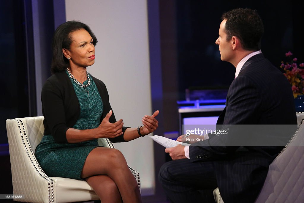 Condoleezza Rice is interviewed by host Brian Kilmeade during a taping of 'FOX And Friends' at FOX Studios on November 5, 2014 in New York City.
