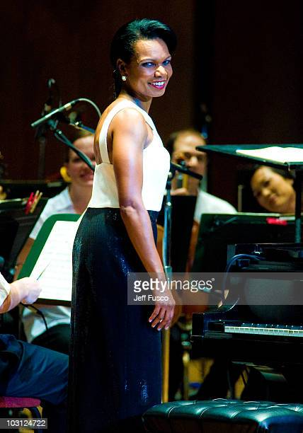 Condoleezza Rice performs with the Philadelphia Orchestra at the Mann Center for Performing Arts on July 27 2010 in Philadelphia Pennsylvania
