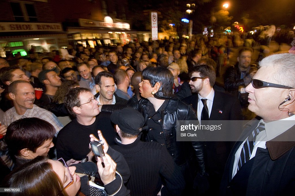 Condoleezza Rice, protected by her security detail, works the crowd along 17th St. NW before the annual High Heel Race on Tuesday night, Oct. 30, 2007.