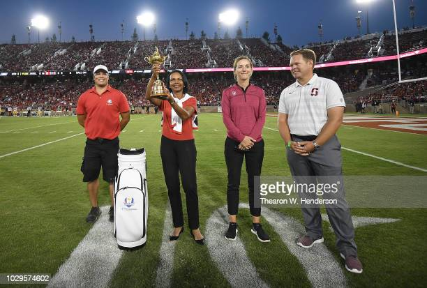 Condoleezza Rice with the Ryder Cup Trophy with Steve Meinki Anne Walker and Conrad Ray on the field during a time out of the third quarter of an...
