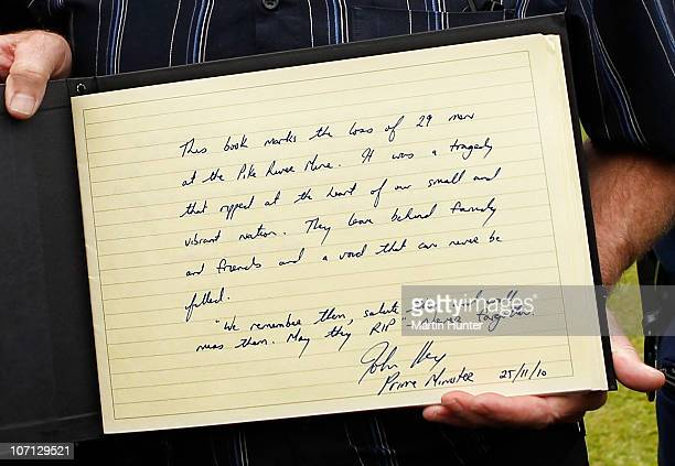 A condolence book been show by Greymouth Mayor Tony Kokshoorn is seen with New Zealand Prime Minister John Key during a visit to Greymouth to meet...