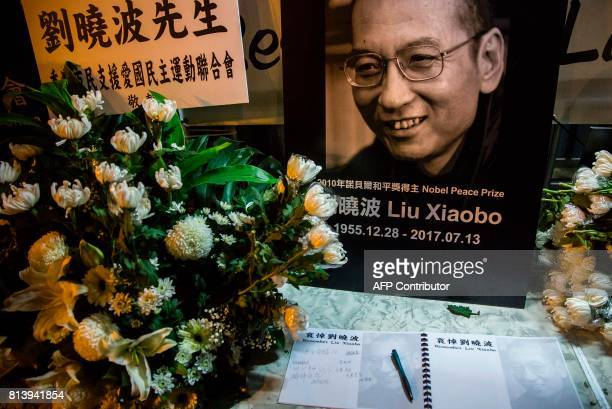A condolence book is displayed among flowers and a portrait of Liu Xiaobo at a makeshift memorial in tribute to late Chinese Noble laureate Liu...