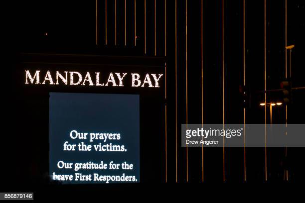 A condolence message is displayed on signage from the Mandalay Bay Resort and Casino October 2 2017 in Las Vegas Nevada Late Monday night a lone...