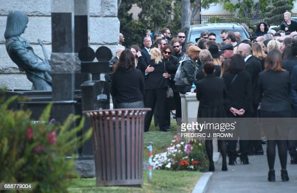 Condolences and hugs are offered and exchanged following a service at the funeral for Soundgarden frontman Chris Cornell on May 26 2017 at the...