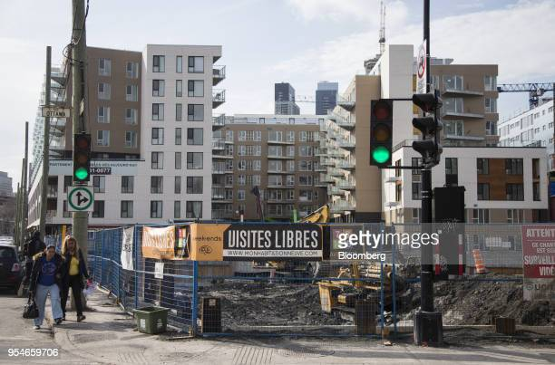 A condominium building stands under construction in the Griffintown neighborhood of Montreal Quebec Canada on Friday April 13 2018 An economic...