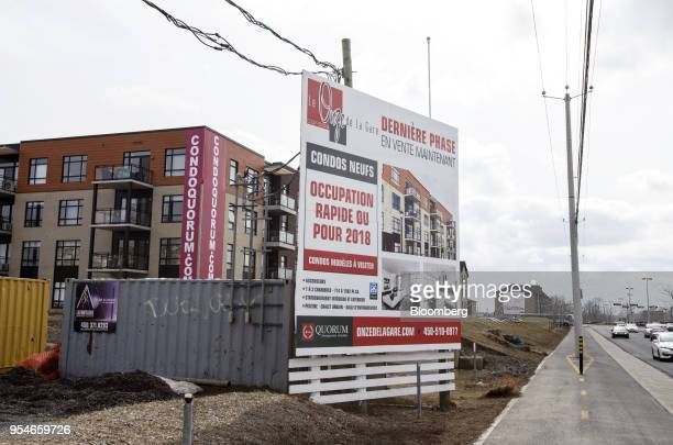 A condominium building stands under construction in the town of VaudreuilDorion Quebec Canada on Friday April 13 2018 An economic revival in Canada's...