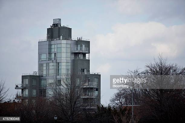 A condominium stands on the edge of McCarren Park in the Brooklyn borough of New York US on Tuesday Feb 25 2014 Home prices in the US climbed at a...
