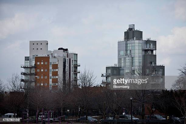 Condominiums stand on the edge of McCarren Park in the Brooklyn borough of New York US on Tuesday Feb 25 2014 Home prices in the US climbed at a...