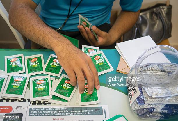 Condoms, bug repellent wipes and literature on the prevention of ZIka and other diseases handed out by health clinic workers during a wellness fair...