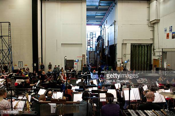Conducter David Charles Abell leads the The BBC Concert Orchestra as they rehearse for the Olivier Awards ceremony at The Royal Opera House on April...