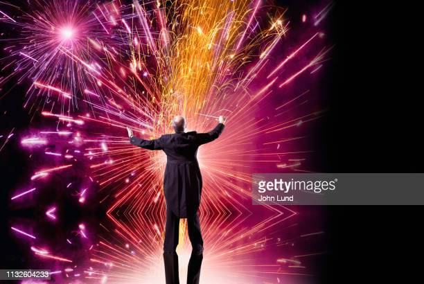 conducting an innovation explosion - conductor's baton stock photos and pictures