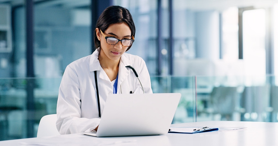 Conducting further research to improve her healthcare services 1169499108